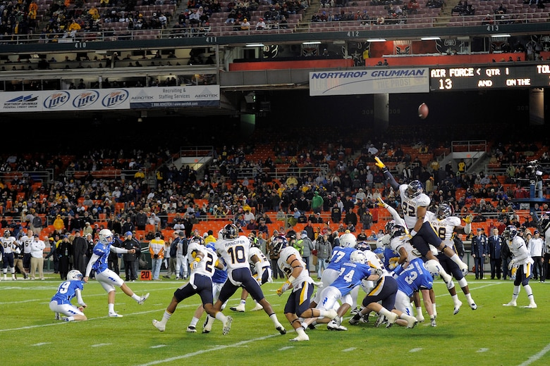 Parker Herrington splits the uprights for a fieldgoal for the Air Force Academy at RFK Stadium Dec 28, 2011 in Washington DC.  The Falcons played the Toledo Rockets in the Military Bowl.   (Air Force photo/Ray McCoy)