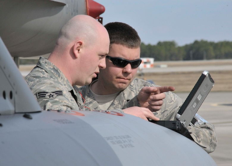 Maintainers from the 179th Fighter Squadron, a subordinate unit of the 148th Fighter Wing out of Duluth, Minn., review technical data prior to preparing an aircrew for a mission at Tyndall Air Force Base, Fla., Jan. 27. The 148th FW is working with the 53rd Weapons Evaluation Group at Tyndall AFB for two weeks to train for their Air Sovereignty Alert missions and to validate their new Block 50 F-16s. (U.S. Air Force photo by Tech. Sgt. John Hoffmann)