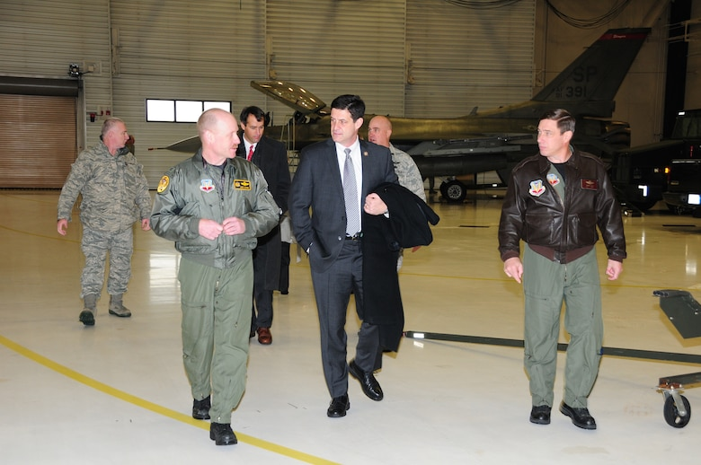 Col. Gerald Ostern, 148th Fighter Wing, Operations Group Commander (left) and Col. Frank Stokes, 148th Fighter Wing, Wing Commander (right) talk with Congressman Cravaack while touring the 148th Fighter Wing in Duluth, Minn.  Congressman Cravaack is visiting the 148th FW less than one month after being sworn into office.  (U.S. Air Force photo by Master Sgt. Ralph J. Kapustka)