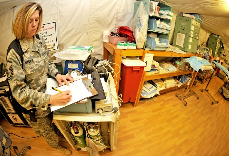 Master Sgt. Apryl Wagner, 467th Casualty Liaison Team non-commissioned officer in charge, fills out a CLT support form with a patient's information inside the combat support hospital Jan. 26, 2011, on Contingency Operating Base Speicher, Iraq. (U.S. Air Force photo by Senior Airman Andrew Lee/Released)