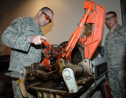 Tech. Sgt. Mark Hopkins, 319th Civil Engineering Squadron, works the civil engineering shop's pipe-fitting machine Jan. 27. Sergeant Hopkins is the Warrior of the Week for Feb. 2 through 9. Warrior of the Week recognizes everyday Airmen working their every day job. (U.S. Air Force photo by Airman Derek VanHorn)