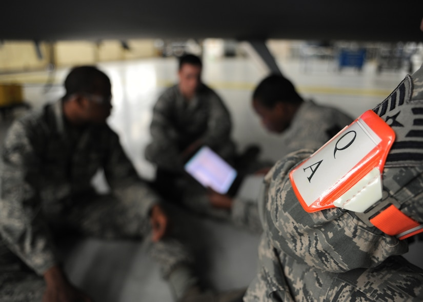 Tech. Sgt. Jonathan Wilson inspects Airmen from the 437th Aircraft Maintenance Squadron during a personal evaluation inspection here Feb. 1. The 437th Maintenance Group, the 315th Maintenance Group and the 628th Logistics Readiness Squadron are preparing for a Logistics Compliance Assessment Program inspection scheduled for Feb. 4.  Sergeant Wilson is a quality assurance inspector with the 437th Maintenance Operations Squadron. The QA office performs over 300 inspections monthly. (U.S. Air Force photo/Senior Airman Katie Gieratz)(RELEASED)