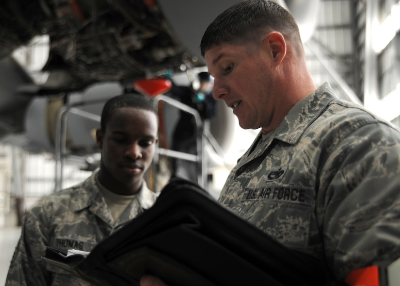 Tech. Sgt. Jonathan Wilson speaks with Airman 1st Class Antonio Thomas during a personal evaluation inspection here Feb. 1 in preparation for the Logistics Compliance Assessment Program inspection Feb. 4. The 437th Maintenance Group, the 315th Maintenance Group and the 628th Logistics Readiness Squadron will be inspected by a team of 52 LCAP inspectors.  Sergeant Wilson is a quality assurance inspector with the 437th Maintenance Operations Squadron and Airman Thomas is a communications navigation specialist with the 437th Aircraft Maintenance Squadron. (U.S. Air Force photo/Senior Airman Katie Gieratz)