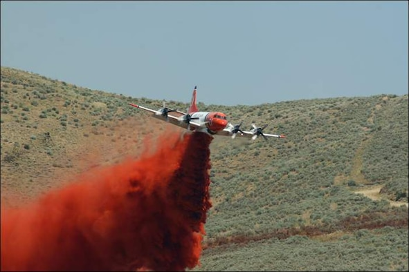 Aero Union's P-3s, modified by the company for firefighting, travel around the country dumping thousands of gallons of red-dyed Phos-chek on wildfires. (Photo courtesy of Aero Union)