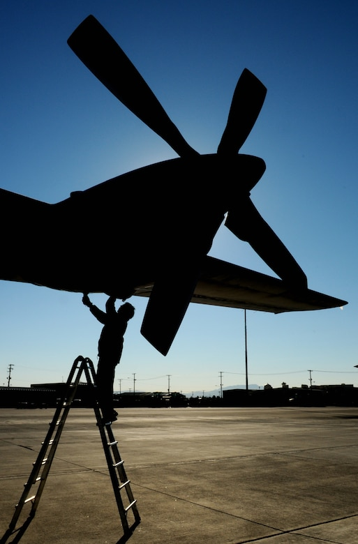 NELLIS AIR FORCE BASE, Nev. -- Adjutant Ludo Geens, aircraft maintainer, performs a post-flight inspection on a C-130 Hercules from the Belgium air force's 20 Squadron Feb. 2 after completing a mission in Red Flag 11-2. The C-130 and Adjutatn Geens are deployed from Melsbroek Air Base, Belgium, to participate in the combined exercise that provides a realistic combat training environment to the U.S. and its allies. (U.S. Air Force photo/Staff Sgt. Benjamin Wilson)