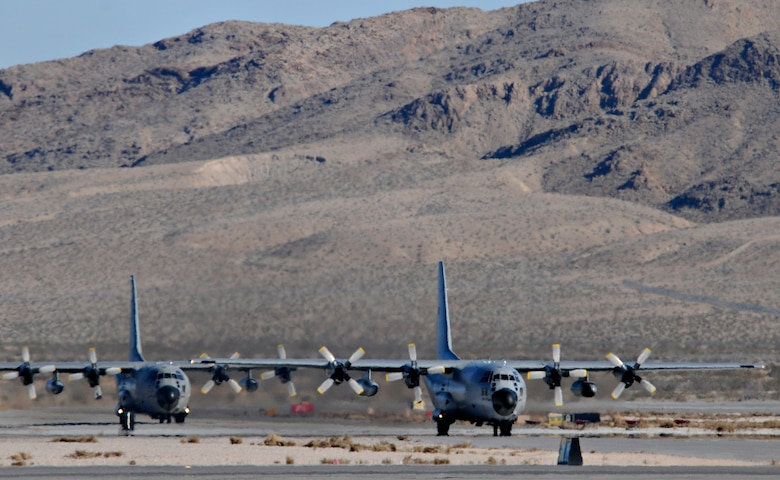 NELLIS AIR FORCE BASE, Nev. -- Two C-130 Hercules from the Belgium air force's 20 Squadron taxi on the flightline Feb. 2 after completing a mission in Red Flag 11-2. The C-130s deployed from Melsbroek Air Base, Belgium, to participate in the combined exercise that provides a realistic combat training environment to the U.S. and its allies. (U.S. Air Force photo/Staff Sgt. Benjamin Wilson)