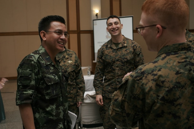 Thai Special Col. Chanchai Romyen, left, commander of the Combined Joint Civil Military Operations Task Force, meets with U.S. Marines and sailors here during an opening conference Feb. 3, 2011, at Chanthaburi, Kingdom of Thailand, for the medical, dental, veterinarian civic actions programs portion of Exercise Cobra Gold 2011. (Official U.S. Marine Corps photo by Lance Cpl. Kris B. Daberkoe/Released)::r::::n::