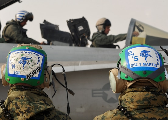 Marine pilots and maintainers from the Marine Fighter Attack Squadron 225 prepare an F-18 Hornet prior to takeoff at Osan Air Base, Republic of Korea, Feb. 2. The Marine squadron is currently on their unit deployment program, where they go to Marine Corps Air Station Iwakuni for six months in which they travel around the Pacific for a few weeks at a time to train their aircrew in different environments. (U.S. Air Force photo/Senior Airman Evelyn Chavez)