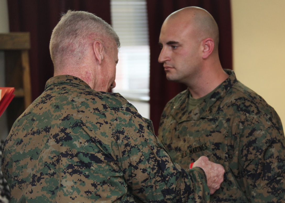 Chief Warrant Officer Marine Gunner Paul Sandy, right, a Swansea, S.C., native and the battalion gunner with Battalion Landing Team, 2nd Battalion, 2nd Marine Regiment, 22nd Marine Expeditionary Unit, stands in a formation just before receiving a Bronze Star Medal with Combat Distinguishing Device during a ceremony at the battalion headquarters aboard Marine Corps Base Camp Lejeune, N.C., Feb. 4, 2011.  Sandy received his Bronze Star Medal for heroic actions while deployed to Afghanistan in 2010.