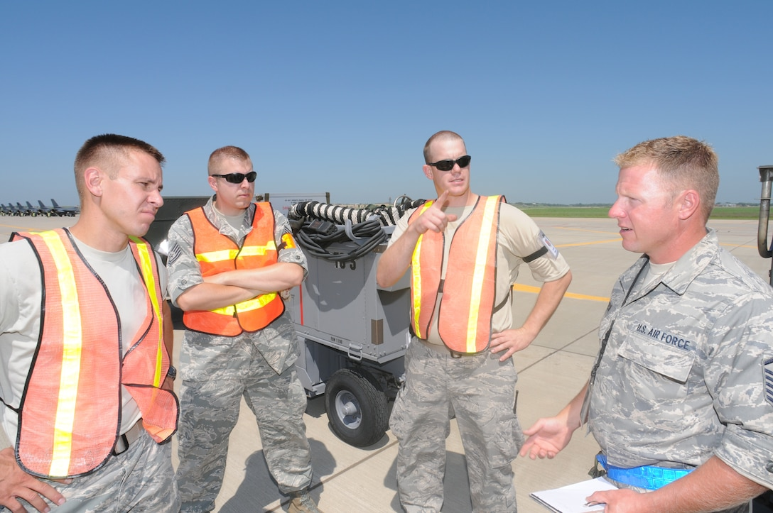 Master Sgt. Eric Wollan, 114th Fighter Wing Safety office, visits with Airmen about safety on the flightline during the September Unit Training Assembly at Joe Foss Field.