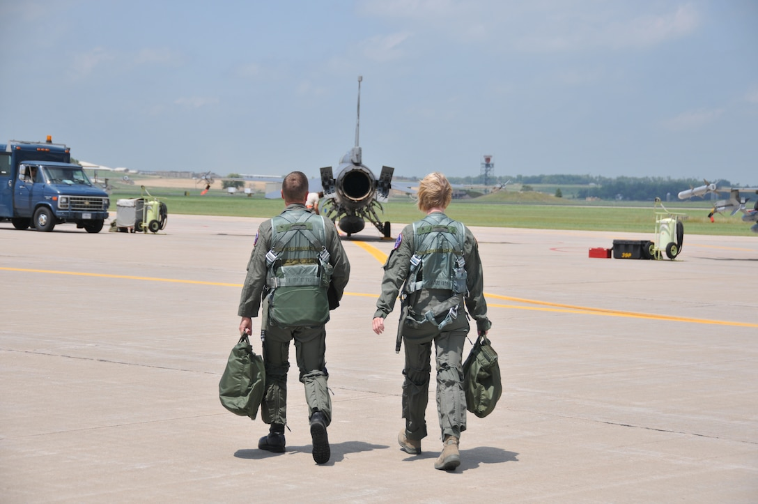 SIOUX FALLS, S.D. -- Lt. Col. Gregory Young and Staff Sgt. Heather Henderson head out on the flight line to prepare for Staff Sgt. Henderson's incentive flight.