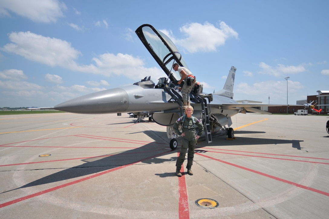 SIOUX FALLS, S.D. -- Staff Sgt. Heather Henderson poses for a shot while the crew of F-16 043 prepare it for Staff Sgt. Henderson's incentive flight.