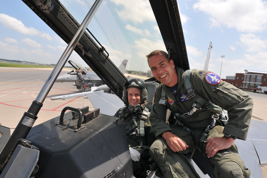 SIOUX FALLS, S.D. -- Lt. Col. Gregory Young, 175th Fighter Squadron Assistant Commander, gives Staff Sgt. Heather Henderson a pre-flight briefing before taking off for her incentive ride.