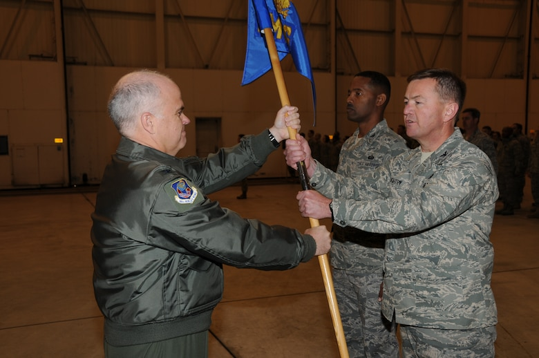 Charlotte, N.C. Col Tony McMillan presents Col Hugh Daughtry the 145th Mission Support Group guidon during the change of command ceremony on December 5, 2010. Photo by Tech. Sgt. Richard Kerner.