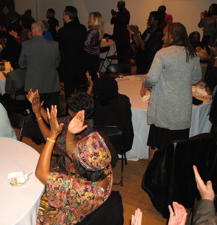 The audience attending the 164th Airlift Wing's annual African-American History Celebration cheers and sings along with a performance at the Historic Stax Museum in Memphis, TN.