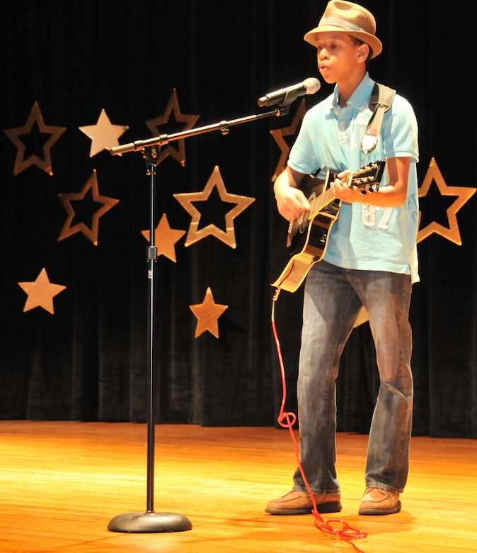 """Jerimiah King, son of Drnetra and Adrian King, performs Moonlight during the annual 2011 """"You Got Talent"""" Family and Teen Talent contest Feb. 5 at the air base theater. Jerimiah was the award winner for the solo act ages 13-18 and will be participating for an AMC level award."""