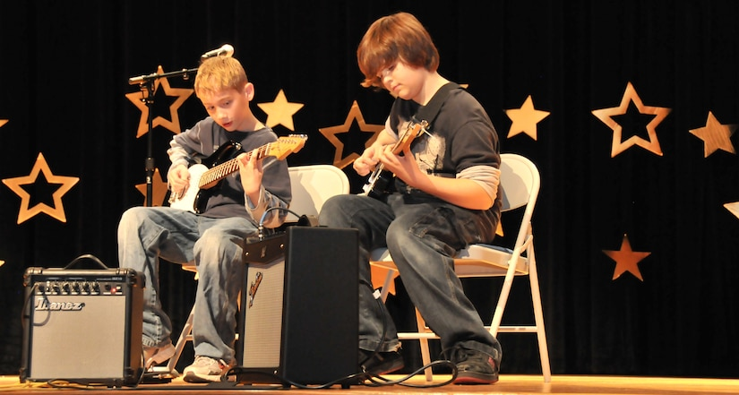 """Christopher Montrose and Corey Leydig strum an instrumental of Fade to Black by Metallica Feb. 5 during the annual """"You Got Talent"""" Family and Teen Talent contest at the air base theater. Christopher is the son of Master Sgt. Mark Montrose and Corey is the son of Master Sgt. Donny Leydig."""