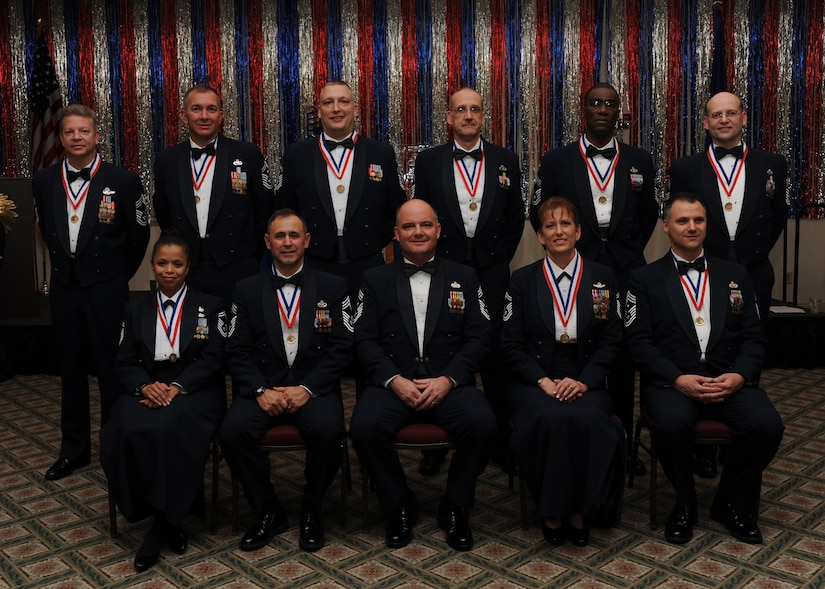 Ten of Team Charleston's 12 chief master sergeant inductees were in attendance at the Joint Base Charleston's chief induction ceremony here, Feb. 5. Chief master sergeants make up one percent of the Air fForce's enlisted force. Not pictured due to deployment are Chief Master Sergeant Selects Michael Gibson and Jeffrey Leeson. (I.S. Air Force photo/Senior Airman Katie Gieratz)