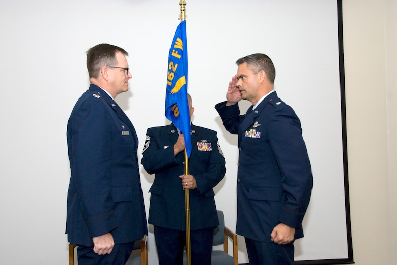 Lt. Col. Andrew MacDonald, 162nd Operations Group commander, salutes Col. Mick McGuire, the wing commander, after assuming command of the group Feb. 6. (U.S. Air Force photo/Master Sgt. Dave Neve)
