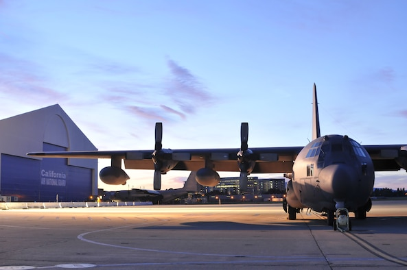 A California Air National Guard MC-130P Combat Shadow aircraft is parked on the flightline during sunrise as members of the 129th Rescue Wing arrive for monthly drill at Moffett Federal Airfield, Calif., Feb. 6, 2011.  (Air National Guard photo by Staff Sgt. Kim E. Ramirez/Released)