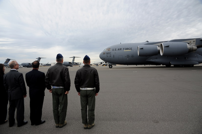 Leadership from Joint Base Charleston welcomes the third of five new C-17s assigned to the 437th Airlift Wing, Feb 3, 2011. The aircraft was flown by Gen. Gary North, commander of Pacific Air Forces, Air Component Commander for U.S. Pacific Command and Executive Director, Pacific Air Combat Operations Staff at Joint Base Pearl Harbor-Hickam, Hawaii. Accompanying General North is Lt. Col. Todd Grooms, 17th Airlift Squadron director of operations. (U.S. Air Force Photo by Tech. Sgt. Chrissy Best)