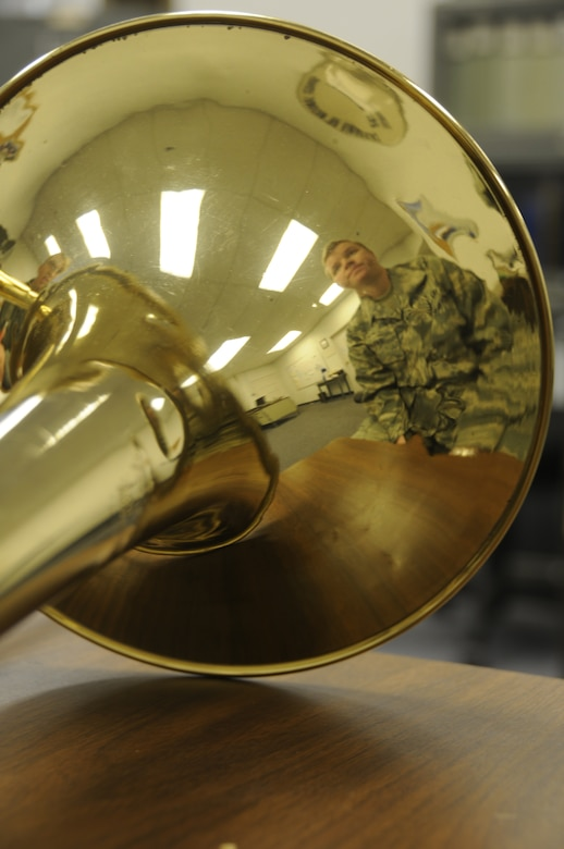 Staff Sgt. Jennifer Parks, a trombone player with the 561st Air Force Band, practices a musical composition at Moffett Federal Airfield, Calif., Dec. 15, 2010. (Air National Guard photo by Tech. Sgt. Ray Aquino/RELEASED)