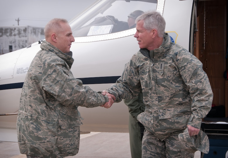 CAPE COD COAST GUARD AIR STATION, Mass. -- General William L. Shelton, Commander, Air Force Space Command, was greeted by Colonel Anthony E. Schiavi, Commander, 102nd Intelligence Wing, upon his arrival at Cape Cod Coast Guard Air Sation, Mass. Feb. 8. The General arrived at the base on his way to visit with the personnel at the 6th Space Warning Squadron, Cape Cod Air Force Station. (U.S. Air Force photo by Master Sgt. Sandra L. Niedzwiecki)