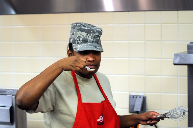Staff Sgt. Asenath Linton, 90th FSS, tastes the gravy she's preparing before lunch at Chadwell Dining Facility on F. E. Warren Air Force Base, Wyo. Jan. 28. (U.S. Air Force photo by R.J. Oriez)