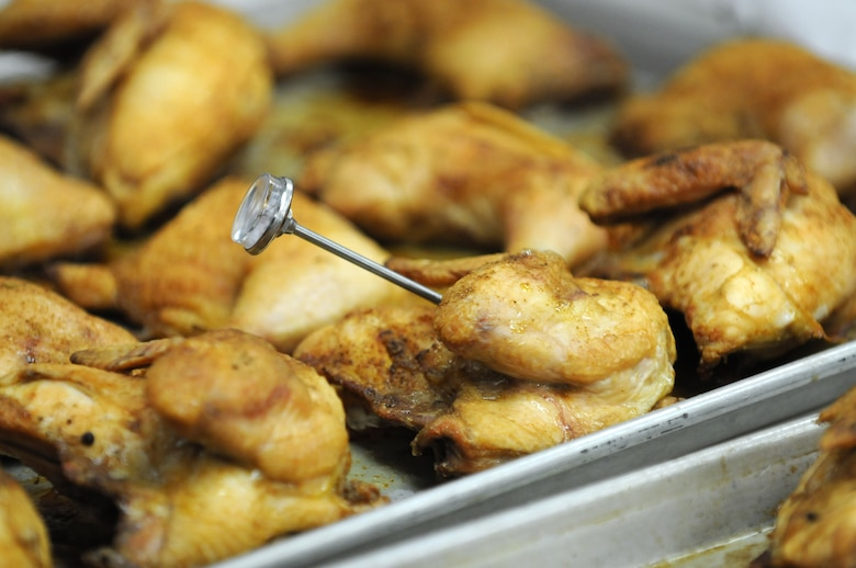 A food thermometer is used to ensure the lunch entrée of baked chicken is thoroughly and safely cooked at Chadwell Dining Facility. (U.S. Air Force photo by R.J. Oriez)