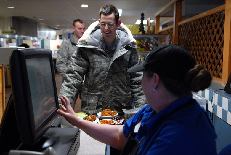Cashier Rosie Hinds, 90th FSS, rings up Airman Daniel Ermis, 90th Missile Maintenance Squadron, lunch on the snack line at Chadwell Dining Facility on F. E. Warren Air Force Base, Wyo. Jan. 28. (U.S. Air Force photo by R.J. Oriez)