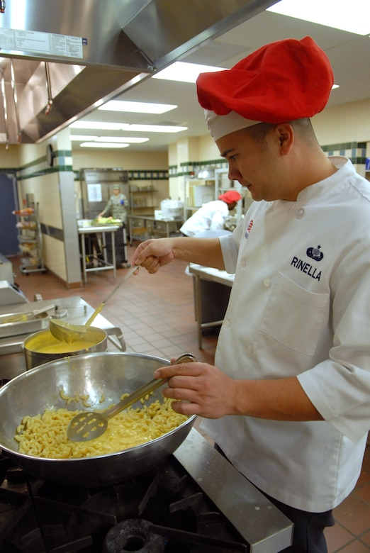 Tech. Sgt. Charles Rinella, 90th FSS, adds the cheese sauce he has just made to macaroni in preparation for lunch at Chadwell Dining Facility on F. E. Warren Air Force Base, Wyo. Jan. 28. (U.S. Air Force photo by R.J. Oriez)