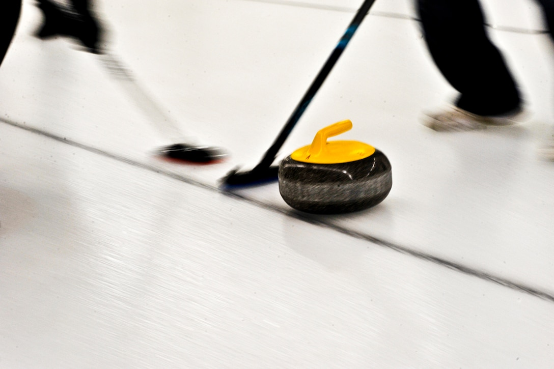 ANCHORAGE, Alaska ? Members of the Air National Guard Curling team sweep to help move their ?stone? farther down the ice. The Canadian team went to the finals of the Top Rock tournament in Anchorage to lose to the Air National Guard team. (U.S. Air Force photo/ Airman 1st Class Jack Sanders)