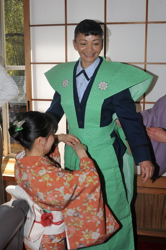 """HINO CITY, Japan -- Lt. Col. Christine Taylor, 374th Surgical Operations Squadron commander, Yokota Air Base, Japan, dresses in """"Kamishimo"""", a formal piece of clothing worn by a samurai or Japanese warrior, in preparation for the annual Bean Throwing Ceremony at Takahata Fudo Temple here Feb. 3. Personnel from Yokota have been participating in the ceremony for more than a decade. (U.S. Air Force photo/Airman 1st Class Krystal M. Garrett)"""