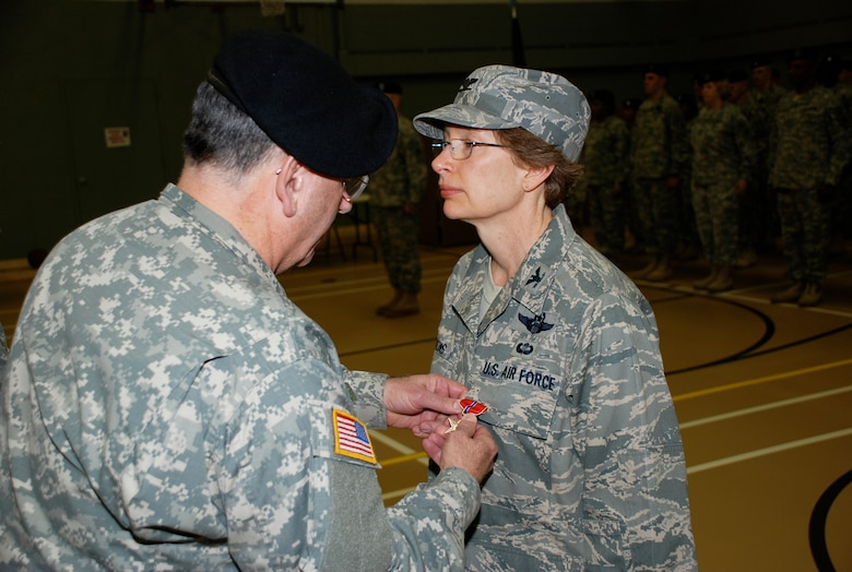 U.S. Air Force Colonel Carol Timmons, Delaware National Guard, has a Bronze Star Medal pinned on her uniform by Maj. Gen. Francis Vavala, Adjutant General, Delaware National Guard, on Feb. 5, 2011 during an award ceremony in Wilmington, Del. Col. Timmons received the award for her meritorious achievement while the deputy commander, 455th Expeditionary Operations Group, 455th Air Expeditionary Wing, Bagram Air Base, Afghanistan, May 3 to Sept. 3, 2008 in support of Operation Enduring Freedom. (U.S. Army photo/Lt. Col. Leonard Gratteri, Delaware National Guard)