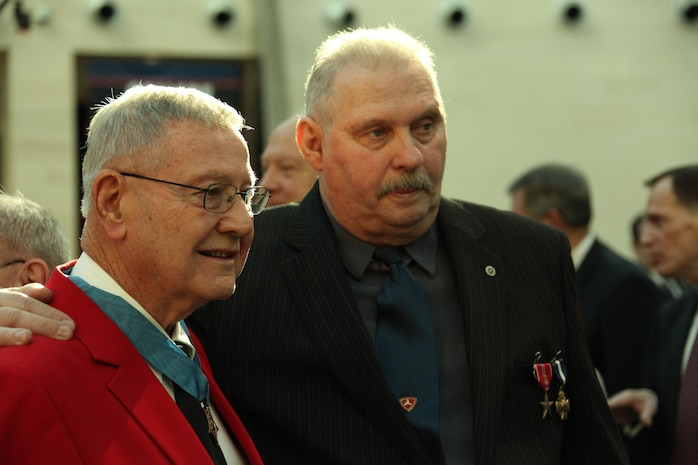Medal of Honor recipient Robert Modrzejewski, who was Ned Seath's commanding officer, stands with him at the National museum of the Marine Corps Feb. 11, 2011. Modrzejewski earned his Medal of Honor during the same mission Seath earned his Navy Cross and Bronze Star.