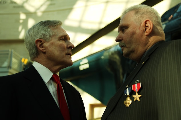 Secretary of the Navy Ray Mabus speaks to Ned Seath after his Navy Cross ceremony Feb. 11, 2011. The Navy Cross was awarded to Seath 45 years after his actions in the Rebublic of South Vietnam, where helped save a company of Marines from being overrun.