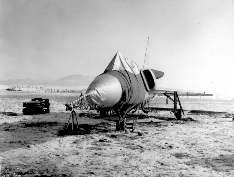 PLANE LANDS ITSELF AFTER PILOT EJECTS - This F-106A (S/N 58-0787) was involved in an unusual incident. During a training mission, it entered an flat spin forcing the pilot to eject. Unpiloted, the aircraft recovered on its own and miraculously made a gentle belly landing in a snow-covered field. (U.S. Air Force photo)