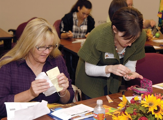New military spouses participate in a purse scavenger hunt during the last Heart Link at the Airman and Family Readiness Center. The next Heart Link class will be held Feb. 22 at the A&FRC in Bldg. 6001. (Air Force photo by Margo Wright)