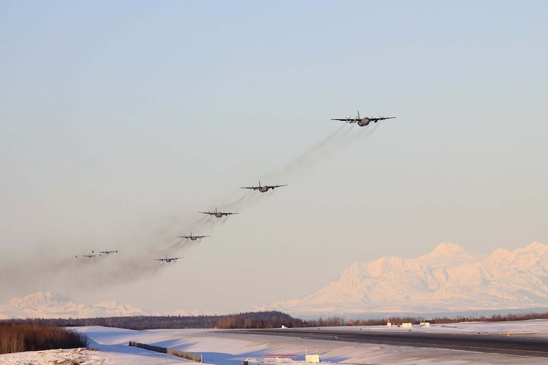 KULIS AIR NATIONAL GUARD BASE, Alaska - Aircraft from the 176th Wing fly over the base in an aerial review, Feb. 12, 2011. Aircraft from the Wing were flown from Kulis to Joint Base Elmendorf-Richardson during a ceremonial flight. The Wing is relocating from Kulis to JBER per the 2005 Defense Base Closure and Realignment proposal.  Alaska Air National Guard photo by Master Sgt. (Ret.) Michael Phillips.