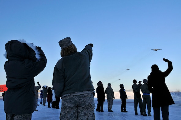 KULIS AIR NATIONAL GUARD BASE, Alaska - Members of the 176th Wing watch as Wing?s aircraft fly over the base, Feb. 12, 2011. Eleven aircraft from the Wing were flown from Kulis to Joint Base Elmendorf-Richardson during a ceremonial flight. The Wing is relocating from Kulis to JBER per the 2005 Defense Base Closure and Realignment proposal.  Alaska Air National Guard photo by Staff Sgt. N. Alicia Goldberger.