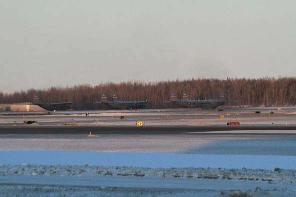 KULIS AIR NATIONAL GUARD BASE, Alaska - Aircraft from the 176th Wing are ready for take-off from the Ted Stevens Anchorage International Airport, Feb. 12, 2011. The aircraft were flown from Kulis to Joint Base Elmendorf-Richardson during a ceremonial flight. The Wing is relocating from Kulis to JBER per the 2005 Defense Base Closure and Realignment proposal.  Alaska Air National Guard photo by Tech. Sgt. Julie Arthur.
