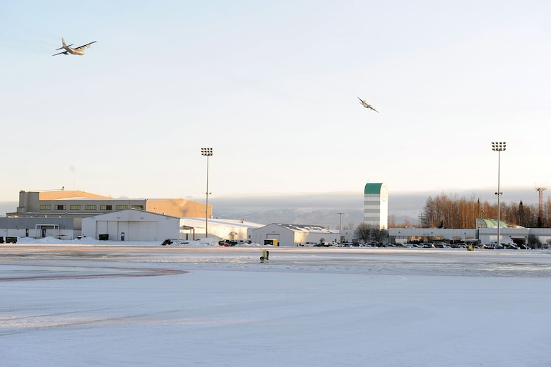 KULIS AIR NATIONAL GUARD BASE, Alaska - Aircraft from the 176th Wing fly over Kulis Air National Guard Base and an empty ramp for the last time, Feb. 12, 2011. Aircraft from the Wing were flown from Kulis to Joint Base Elmendorf-Richardson during a ceremonial flight. The 176th Wing is relocating from Kulis to JBER per the 2005 Defense Base Closure and Realignment proposal.  Alaska Air National Guard photo by Master Sgt. Shannon Oleson.