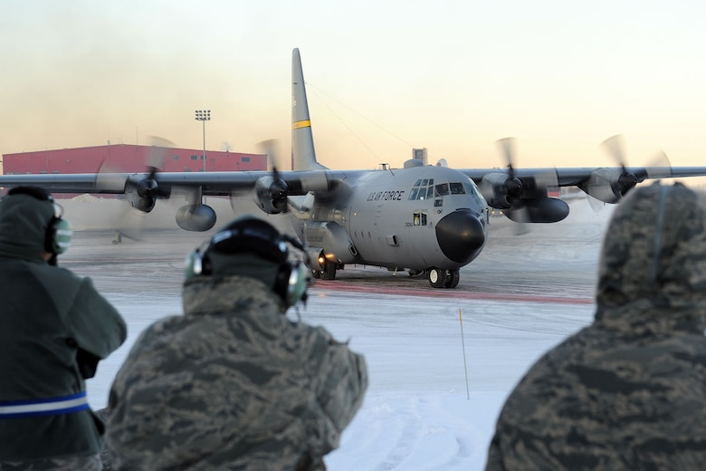 KULIS AIR NATIONAL GUARD BASE, Alaska - A C-130 from the 144th Airlift Squadron is the last aircraft to leave the ramp on the base, Feb. 12, 2011. Eleven aircraft from the 176th Wing were flown from Kulis to Joint Base Elmendorf-Richardson during a ceremonial flight. The Wing is relocating from Kulis to JBER per the 2005 Defense Base Closure and Realignment proposal.  Alaska Air National Guard photo by Master Sgt. Shannon Oleson.