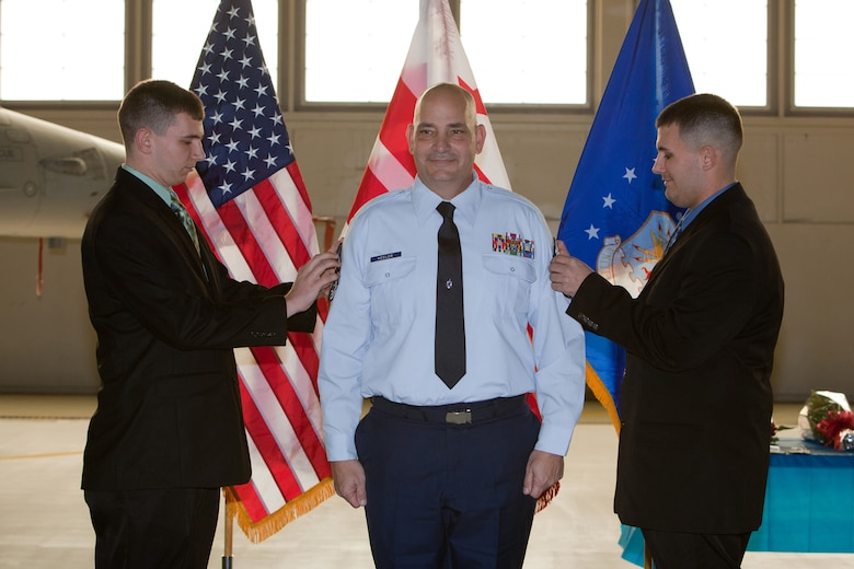 Chief Master Sgt. Louis R. Keeler gets pinned by his sons Jonathan and Zachary during his promotion ceremony. The 113th Maintenance Squadron held its first ever pining of three Chief Master Sergeants during a promotion ceremony on February 12, 2011 at Hanger 18, Andrews Air Force Base (U.S Air Force photo by Tech. Sgt. Gareth Buckland/Released)