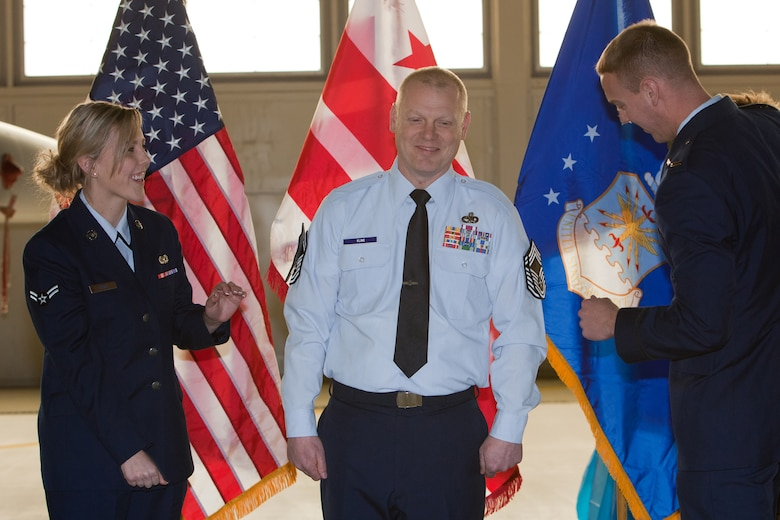 CMSgt Kevin Kling gets pinned by his son 2nd Lieutenant Adam Kling and daughter A1C Jenna Kling during his promotion ceremony. The 113th Maintenance Squadron held its first ever pining of three Chief Master Sergeants during a promotion ceremony on February 12, 2011 at Hanger 18, Andrews Air Force Base (U.S Air Force photo by Tech. Sgt. Gareth Buckland/Released)