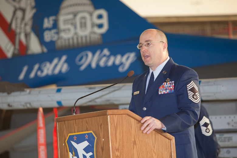 CMSgt James T. Mathews address the audience during his promotion ceremony. The 113th Maintenance Squadron held its first ever pining of three Chief Master Sergeants during a promotion ceremony on February 12, 2011 at Hanger 18, Andrews Air Force Base (U.S Air Force photo by Tech. Sgt. Gareth Buckland/Released)