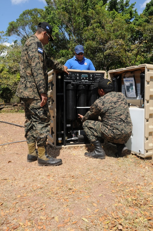 SOTO CANO AIR BASE, Honduras -- Joint Task Force-Bravo, the Honduran military and the Comisión Permanente de Contingencias, trained and exercised on equipment together here Feb. 2 through 10, on equipment that can enable them to provide aid following disasters. Here Honduran military representatives National Defense University assistance, set up the water desalination machine. This machine is a portion of the Prepositioned Exercise Assistance Kit which filters murky or salt water into drinkable water. JTF-Bravo is committed to full partnerships with Central American governments in training and missions to support security, stability and prosperity throughout the region. (U.S. Air Force photo/Staff Sgt. Kimberly Rae Moore)