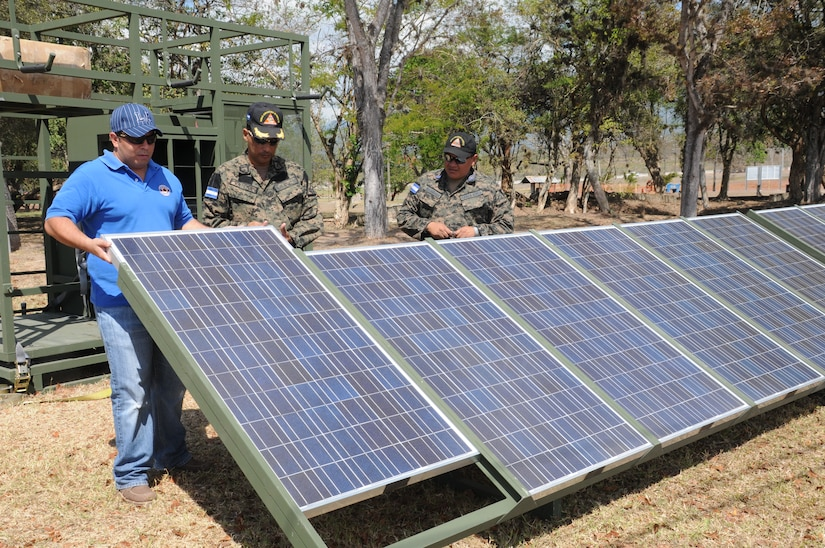 SOTO CANO AIR BASE, Honduras -- Joint Task Force-Bravo, the Honduran military and the Comisión Permanente de Contingencias, trained and exercised on equipment together here Feb. 2 through 10, on equipment that can enable them to provide aid following disasters. Here Honduran military representatives National Defense University assistance, set up the solar panels that produces hybrid power.  The panels are a portion of the Prepositioned Exercise Assistance Kit. JTF-Bravo is committed to full partnerships with Central American governments in training and missions to support security, stability and prosperity throughout the region. (U.S. Air Force photo/Staff Sgt. Kimberly Rae Moore)