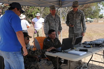 SOTO CANO AIR BASE, Honduras -- Joint Task Force-Bravo, the Honduran military and the Comisión Permanente de Contingencias, trained and exercised on equipment together here Feb. 2 through 10, on equipment that can enable them to provide aid following disasters. Here Honduran military representatives with JTF-B assistance, set up the communications kit which is a portion of the Prepositioned Exercise Assistance Kit. JTF-Bravo is committed to full partnerships with Central American governments in training and missions to support security, stability and prosperity throughout the region. (U.S. Air Force photo/Staff Sgt. Kimberly Rae Moore)