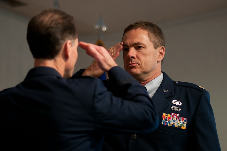 Major James Treu, 139th Airlift Wing, accepts command of the new Comptroller Flight from 139th Wing Commander, Mike McEnulty during a ceremony, February 5, 2011. (U.S. Air Force photo by Master Sgt. Shannon Bond/Released)